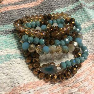 Set of five glass beaded bracelets